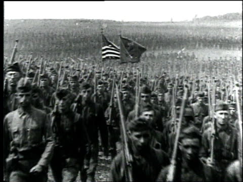 wwi soldiers march in formation displaying the us flag / france - 1918 stock videos and b-roll footage