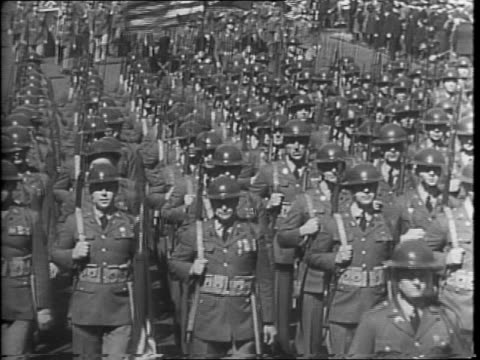 stockvideo's en b-roll-footage met soldiers march in parade with us capitol building in background / general douglas macarthur speaks to camera / large crowd of people seated /... - geallieerde mogendheden