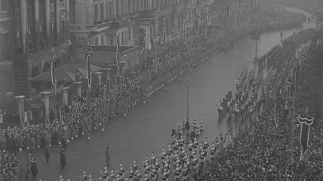 soldiers march in the funeral procession for king george v near hyde park corner in london, england. - military parade stock videos & royalty-free footage