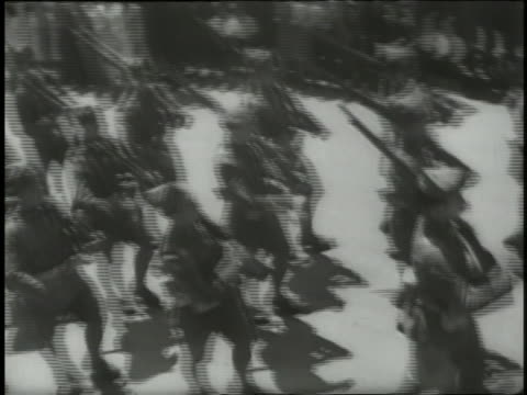 soldiers march in the street following the spanish civil war as spectators applaud. - royalty stock videos & royalty-free footage