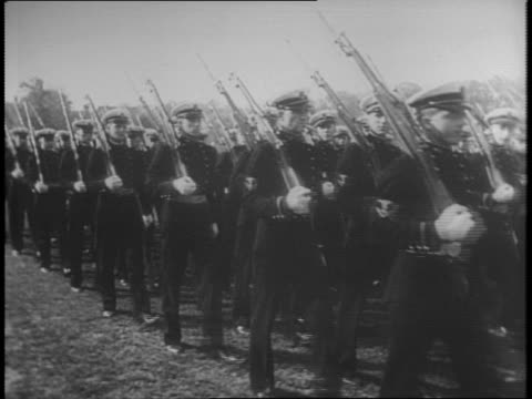 soldiers march in uniform with rifles at annapolis naval academy / older men dressed in suits walk towards camera / flag in ground soldiers marching... - 1941 stock videos & royalty-free footage