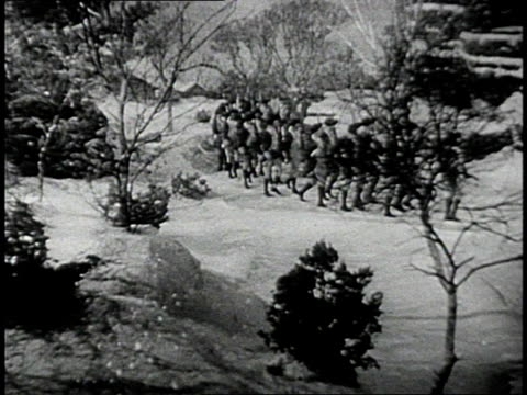 REENACTMENT Soldiers march through snow / United States
