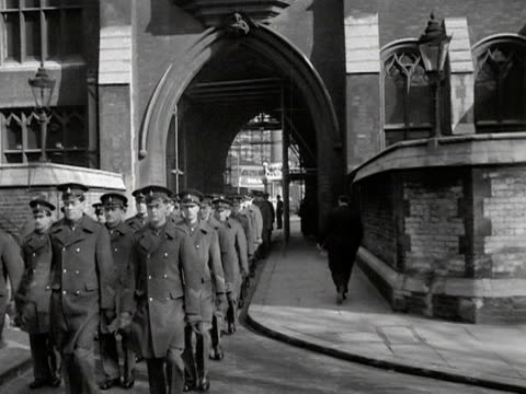 soldiers march towards westminster abbey during preparations for the coronation of elizabeth the second. 1953. - westminster abbey stock videos & royalty-free footage