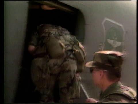 soldiers march with equipment into carrier plane / plane takes off for combat destination - operation desert storm bildbanksvideor och videomaterial från bakom kulisserna