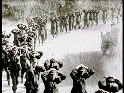 soldiers march with hands on their heads in surrender / hitler speaks with his fist raised in the air - surrendering stock videos & royalty-free footage