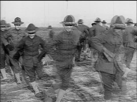 b/w 1917 soldiers marching in comic fashion at military training camp / ww i / documentary - 1917 stock videos & royalty-free footage
