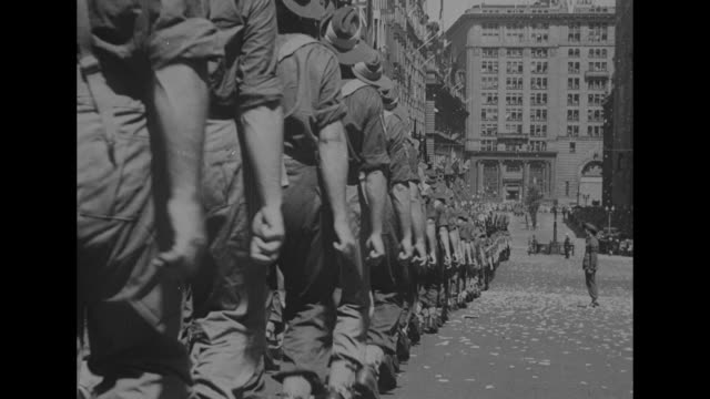 soldiers marching in formation down street crowds on either side military band in foreground / military band with soldiers behind it marching down... - ticker tape stock videos and b-roll footage