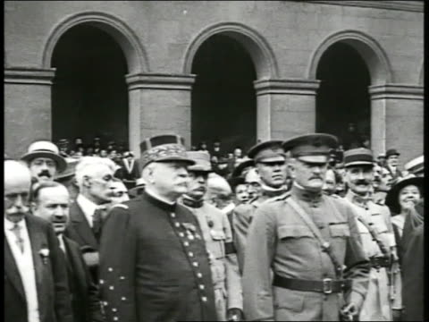soldiers marching in formation on street lined w/ people ws french marshal joffre standing next to us general john j 'blackjack' pershing in front of... - anno 1918 video stock e b–roll