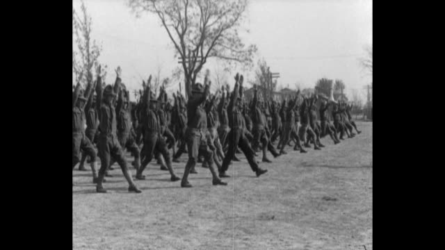 soldiers marching in formation / performing calisthenic exercise / bayonet training including using them on dummies / attached french officers... - esercito militare francese video stock e b–roll