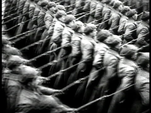 vídeos de stock, filmes e b-roll de soldiers marching in parade formation. one group marching w/ boyonets on rifles pointed forward. josef stalin looking up. soviet airplanesin flight.... - 1935