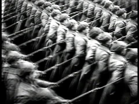 vídeos y material grabado en eventos de stock de soldiers marching in parade formation. one group marching w/ boyonets on rifles pointed forward. josef stalin looking up. soviet airplanesin flight.... - 1935