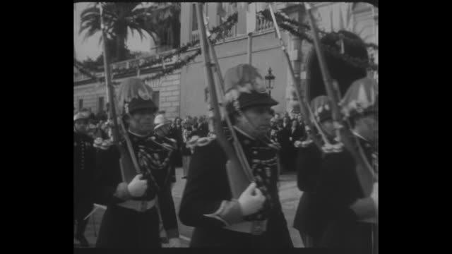 soldiers marching in parade / prince rainier iii walks along balcony calls his dog / he pets dog with background of harbor and city / ws view from... - grace kelly actress stock videos and b-roll footage