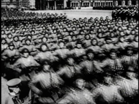 soldiers marching in parade while people celebrating in streets / russia - guerra fredda video stock e b–roll