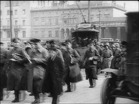 b/w 1918 soldiers marching in street past trolleys / germany / documentary - 1918 stock videos and b-roll footage