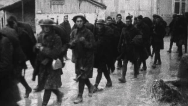 vidéos et rushes de soldiers marching near front / france - soldat
