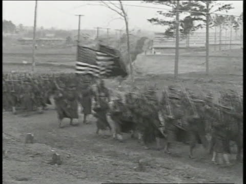 soldiers marching on rural road flag bearers carrying us flag us marines logo flag pan many cheering soldiers waving hats ws soldiers walking up... - 1918 stock videos and b-roll footage