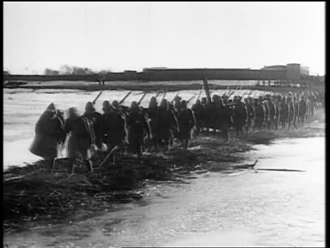B/W 1931 soldiers marching over thatched bridge / Japan invading Manchuria