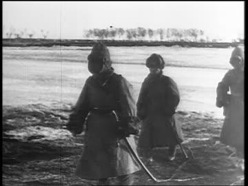 vidéos et rushes de soldiers marching over thatched bridge / japan invading manchuria - 1931