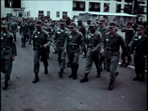 soldiers mustering at attention / soldiers sharing cigarettes