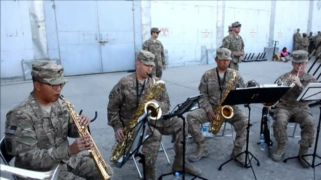 us soldiers observed a moment of silence on thrusday during a memorial ceremony at a military base in bagram in remembrance of those who perished 13... - bagram video stock e b–roll