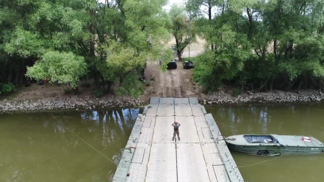 soldiers of 1st squadron 2nd cavalry regiment trained with soldiers of the ohio national guard and engineers of the hungarian defense forces to work... - pontoon bridge stock videos and b-roll footage