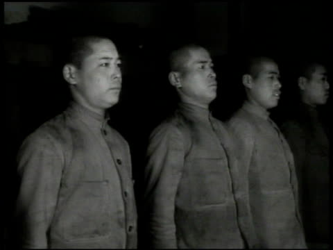 stockvideo's en b-roll-footage met soldiers of imperial japanese army 3rd infantry regiment standing in line at attention. officer in uniform. two soldiers hanging up washed clothing,... - 1936