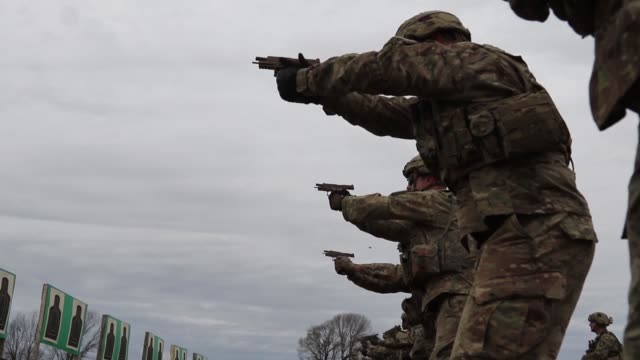 soldiers of the 101st test firing the m17 pistol at the range on dec 5 2017 these soldiers are among the first to fire the army's new handgun... - fort campbell video stock e b–roll