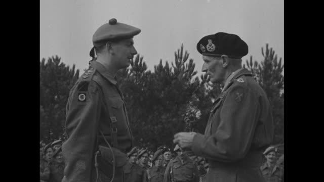 vídeos de stock, filmes e b-roll de soldiers of the 15th infantry division of the british army stand at attention in a field to receive medals from field marshal bernard law montgomery... - bernard l. montgomery