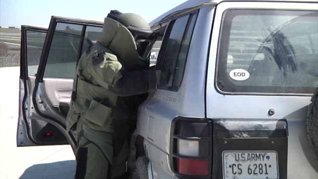 soldiers of the 759th explosive ordinance disposal company performed remote entry procedures during a vehicle born ied training on camp bondsteel... - disposal stock videos and b-roll footage