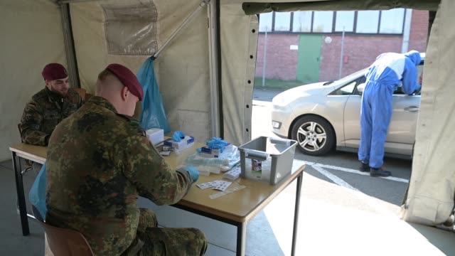 soldiers of the bundeswehr, germany's armed forces, receive people with possible covid-19 symptoms at a converted hall for coronavirus testing at the... - germany stock videos & royalty-free footage