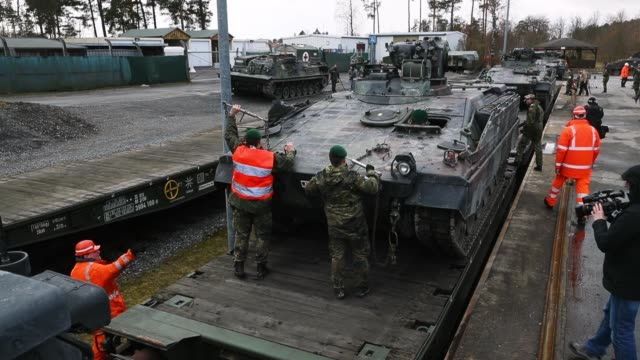 Soldiers of the Bundeswehr the German armed forces load Marder light tanks onto trains for transport to Lithuania on February 21 2017 in Grafenwoehr...