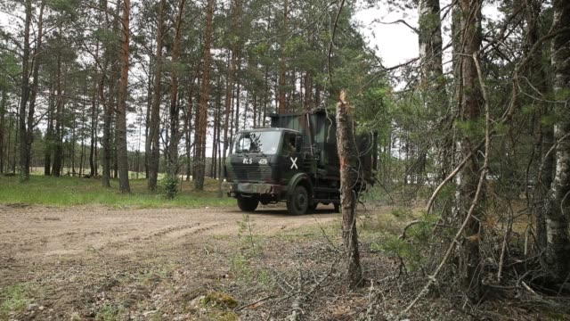 soldiers of the bundeswehr the german armed forces move into position to recover a kzo reconaissance drone following a successful mission during... - lithuania stock videos & royalty-free footage