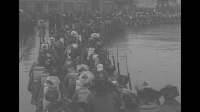 soldiers of the chinese first army arrive in mukden, walk through rainy streets / note: exact day not known - manchuria stock videos & royalty-free footage