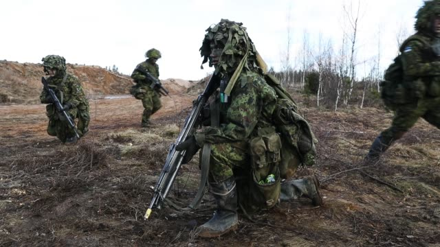 soldiers of the estonian defence forces move toowards an enemy position during a joint military combat exercise with us army troops on march 23 2017... - military exercise stock videos and b-roll footage