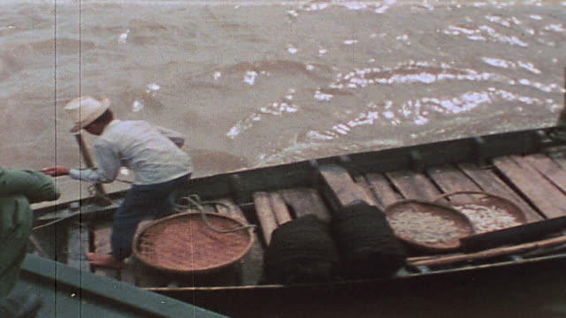 soldiers on alert inspecting sampan in mekong delta tributary / vietnam - sampan stock videos & royalty-free footage