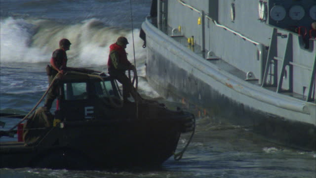 cu soldiers on amphibious landing barge trying to attach to tug boat - us marine corps stock videos & royalty-free footage