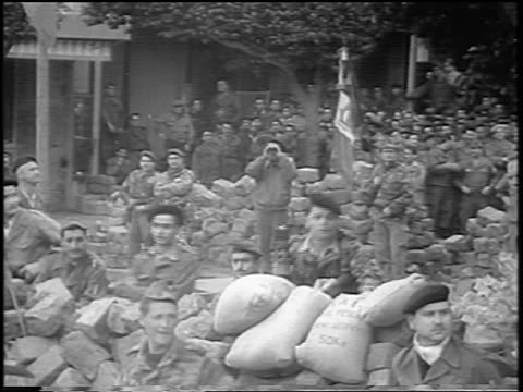 B/W 1960 soldiers on barricade / Algeria / newsreel