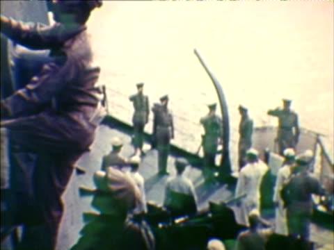 MS HA TU COMPOSITE Soldiers on board of vessel during Japanese surrender