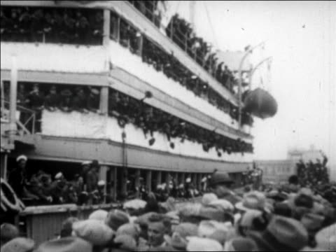 b/w 1927 soldiers on crowded ship waving to crowd on dock as ship pulls away / san francisco - 1927 stock videos & royalty-free footage