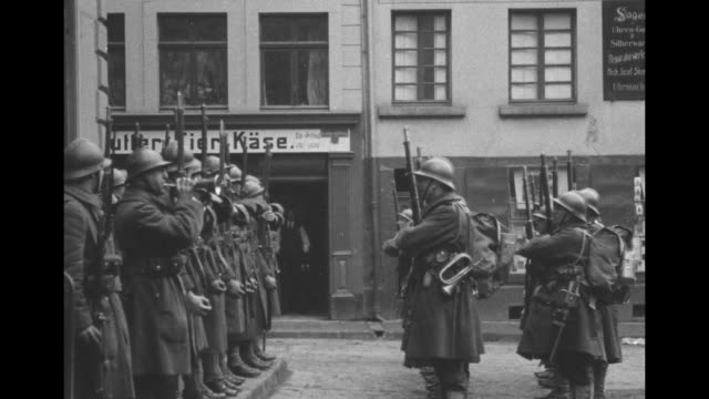 soldiers on german street perform rifle drills and a bugler plays / note exact month/day not known - erster weltkrieg stock-videos und b-roll-filmmaterial