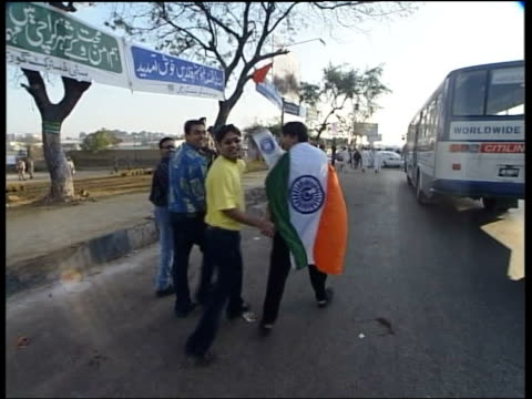 soldiers on guard outside stadium 'welcome indian team' banner tilt down armed soldier on guard cricket fans along wearing sshirts with india and... - pakistani flag stock videos & royalty-free footage