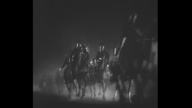 1861 Soldiers on horseback race across the screen under cover of darkness