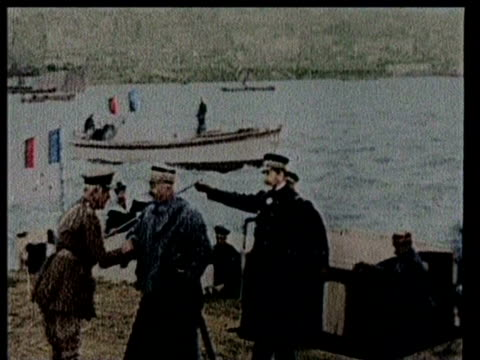 stockvideo's en b-roll-footage met soldiers on horseback / soldiers lined up for inspection / french army officers exit a ship and shake hands french flags in background / battleship... - turkije midden oosten