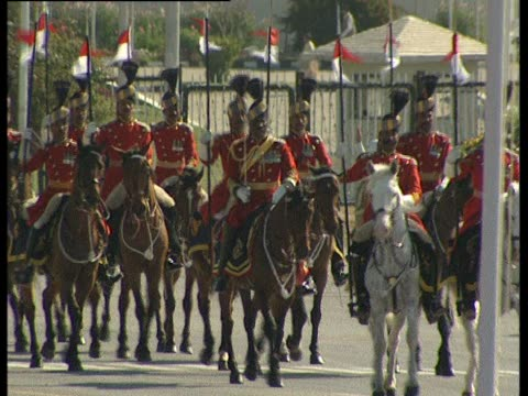 soldiers on horseback take part in the national day parade in islamabad - recreational horse riding stock videos & royalty-free footage