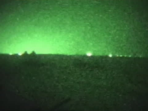 soldiers on patrol in fallujah are seen though a night vision scope. - al fallujah stock videos & royalty-free footage