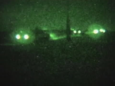 soldiers on patrol in iraq are seen though a night-vision scope. - al fallujah stock videos & royalty-free footage