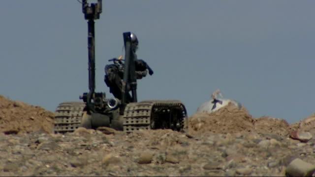 soldiers on patrol on the front line in kandahar remote control camera on catepillar tracks/ explosion - kandahar bildbanksvideor och videomaterial från bakom kulisserna