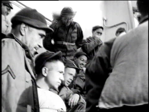 soldiers on ship's deck listening to accordion band playing / soldiers in circle on floor playing cards / soldiers gathered in group watching... - kraneinstellung stock-videos und b-roll-filmmaterial