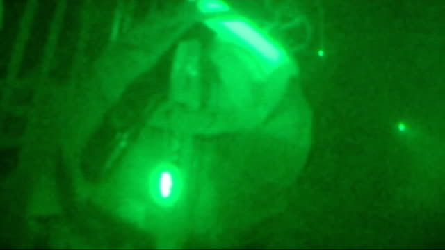 Kandahar Province Maiwand SHOTs British soldiers of Gurkhas regiment standing next Chinook helicopter INT GREEN NIGHT VISION British soldiers seated...