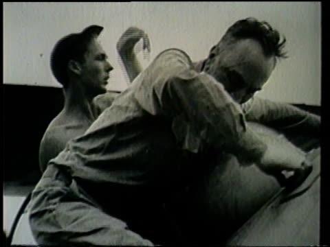 soldiers on the ground help an injured soldier out of his airplane. - eddie rickenbacker bildbanksvideor och videomaterial från bakom kulisserna